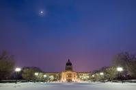 Saskatchewan Legislative Building on a moon-lit winter night
