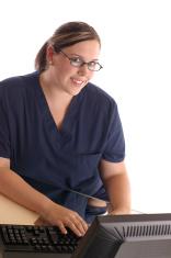 Smiling Female Nurse at Computer Workstation