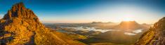 Glorious mountain sunrise golden light on idyllic wilderness Hig