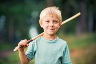 Little boy playing knight