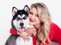 Young girl with her husky dog isolated on white