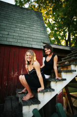 Two Friends Sitting on Old Stairs