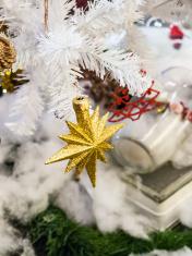 Christmas star on white christmas tree, soft focus, blur backgro