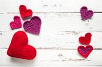 Crochet hearts on white table