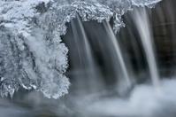Winter Cascade Framed by Ice