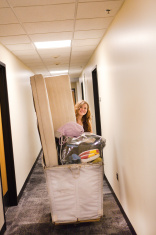 University Student Moving into Campus Dormitory