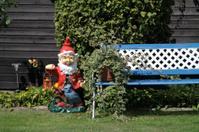 Garden gnome and garden bench