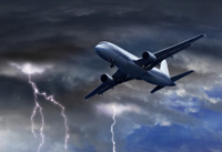 Passenger air plane approaching thunder storm