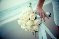 Bride hands on yellow flowers