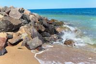 waves beating stones