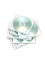 messy cd jewel case stack on white