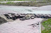 the fallen sidewalk from a stone blocks