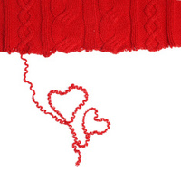 Heart shaped red yarn on white background