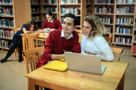 Two Turkish Students with Laptop at University Library, Istanbul