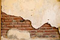 Brick behind Old Plaster