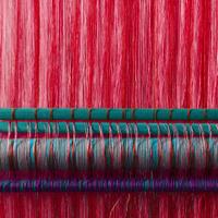 Handmade silk textile industry, silk scarf on a old machine