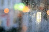 window rain blurred city lights