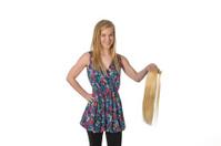 Girl holding hair extension