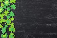 Green Clover on Chalkboard Background