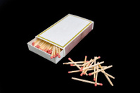 matches and matchbox collection isolated on black background