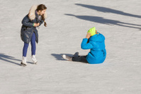 falling teenager on the ice rink