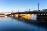 Bridge over the frozen river Daugava in Riga in winter