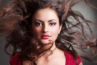 Woman in red dress. Elegant Brunette