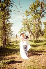 Cowboy Groom Carrying His Bride