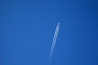 long trail of jet plane on blue sky