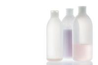 Old shampoo bottle isolated on white background.