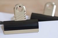Metal Bulldog clip holding paperwork