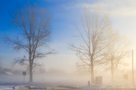 Winter landscape view fields buildings covered snow fog