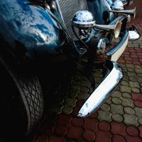 Old retro or vintage car front side