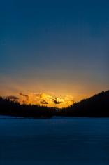 Sun set over a frozen lake