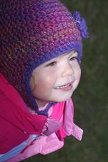 Baby girl in pink, purple flower hat