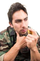 distraught military soldier veteran ptsd drinking a shot of liqu