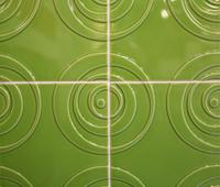 Green square tiles with circular motif