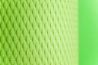 Yellow/green textured, weaved lamp shade background.
