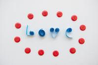 LOVE text from blue paper with red clasper