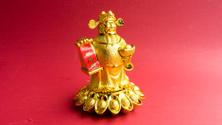 God of Wealth (Cai Shen) with gold ingot (Yuan Bao)