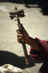 Tibetan holding a prayer wheel