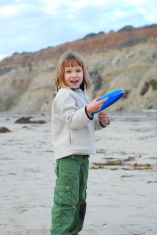 Girl with Frisbee on the beach