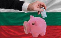 Funding euro into piggy rich bank national flag of bulgaria