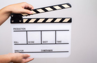 hand holding film Clapperboard