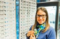 Eye exam...Young woman at the optometrist,selection of eyewear