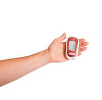 Woman testing for high blood sugar.