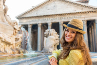 Smiling woman near fountain of the pantheon in rome, italy