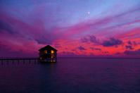 Water bungalow and sunset on Maldives island