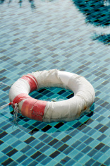 Old life buoy in swimming pool