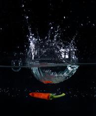 Red Jalapeno Chilli splashing in water
